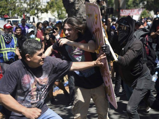 "Anarchists Antifa Berkeley (Josh Adelson / Associated Press   by Joel B. Pollak28 Aug 20170 				28 Aug, 201728 Aug, 2017  Berkeley police deliberately allowed masked ""Antifa"" anarchists to jump a barricade and attack a demonstration by a peaceful right-wing group on Sunday, leading..."