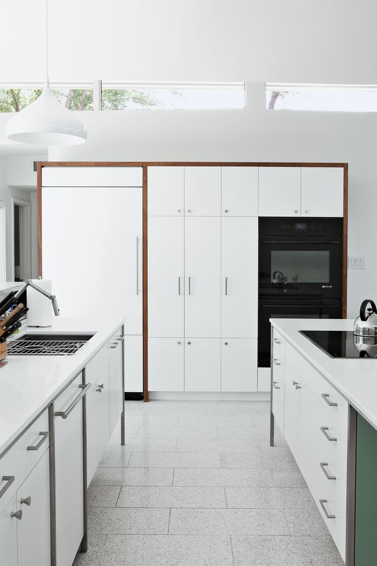 The cooktop, refrig-erator, and wall ovens are by Jenn-Air; the sink and faucet are by Kohler; and the countertops are from Caesarstone.  Photo by Brent Humphreys.