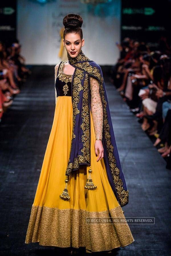 A model displays a creation by designer Vikram Phadnis during the Lakme Fashion Week Winter/Festive 2014, held in Mumbai, on August 24, 2014. (BCCL)See more of : Lakme Fashion Week Winter/Festive 2014