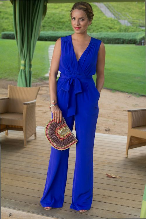 A bright blue jumpsuit is perfect for this season's festivities. Add a patterned clutch or colorful accessories and you'll look effortlessly gorgeous at your next summer party or BBQ!