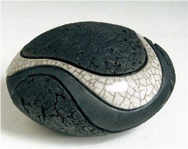 Pinched, grogged, SC80 clay. Raku-fired clear glaze outside, black glaze inside.