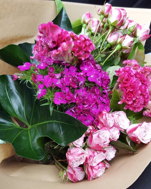 Pops of pink bouquet using roses, celosia and sweet william.
