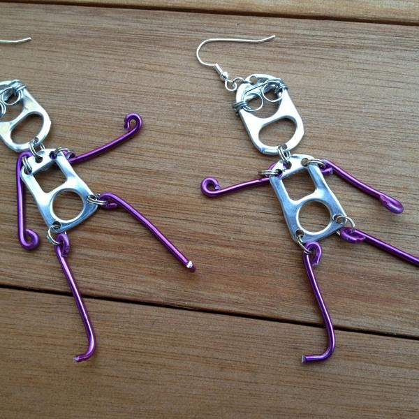 cute earrings made from can openers and purple wire