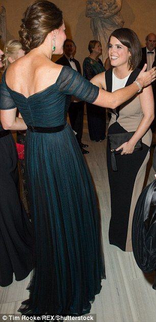 And the Duchess was pictured enthusiastically greeting Princess Eugenie with a kiss at a gala in New York in 2014