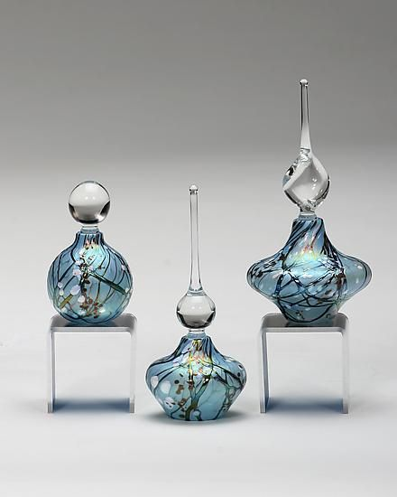 "Cherry Blossom Perfume Bottles: ""Blue"".. Art Glass created by Bryce Dimitruk - using a blow pipe like a paint brush, the artist weaves silvered glass and minerals into decorative layers, creating a petite blown perfume bottle that conjures up images of cherry blossoms against a blue sky."