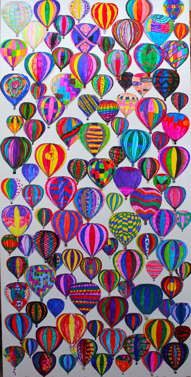 3rd grade art project. Kids decorated 3 different sizes of hot air balloon using markers. Balloons were mounted to a canvas using varying layers of foam tape to create dimension.