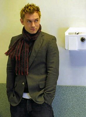 Blazer, check. Scarf, check.  Jude Law, check it out!