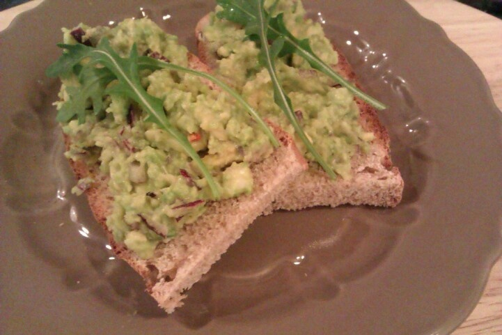 Home-baked whole wheat rye bread with guacamole