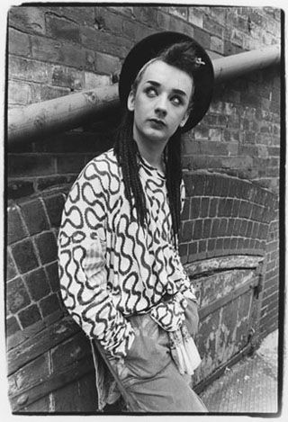 Boy George / photo by Laura Levine / 1982.  As a reaction to the punk movement, New Romantics wore luxurious Edwardian and Victorian styles.  Here, Boy George embodies a softer, more thoughtful masculinity.  #subvert1980s