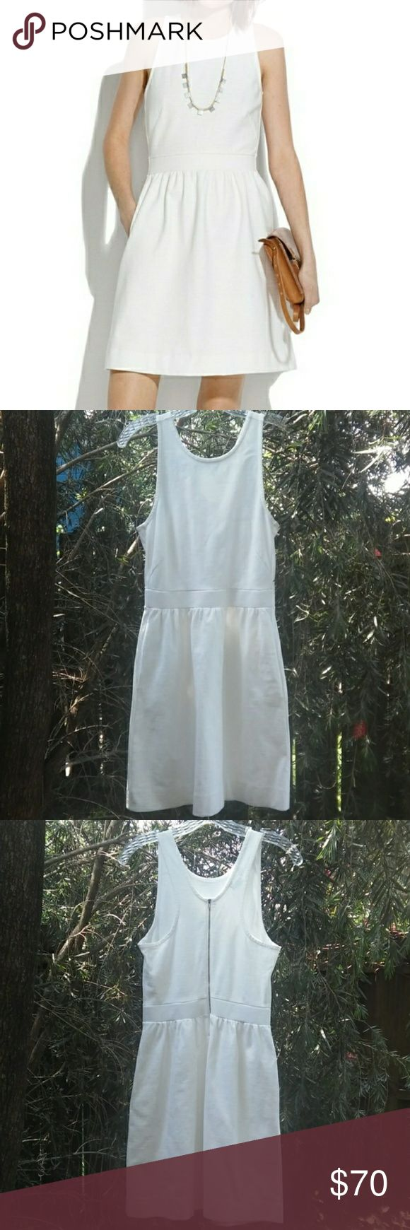 "Madewell White Dress Madewell White Dress. It is *Sold out* on website. Pristine pre-owned condition, like new. Super cute side pockets with a zipper back. It will come to you already dry-cleaned and ready to wear. Dry clean tag attached, I saved you $7.00 already! I took the picture of the manufacturer tag right before it was dry cleaned. A simple but sexy racerback style with an exposed zip. Supercool, sporty and easy. True to size, waisted. Falls 35"" from shoulder. Cotton with a hint of…"