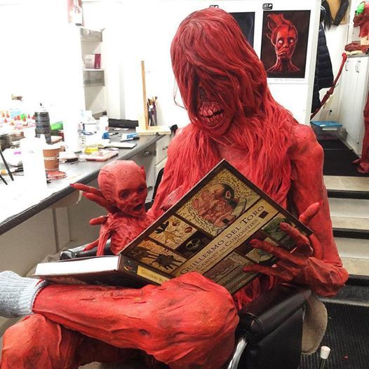 Monsters love reading books too! Actor Javier Botet as Enola in full body prosthetics, created by David Martí for the movie CRIMSON PEAK (2015).