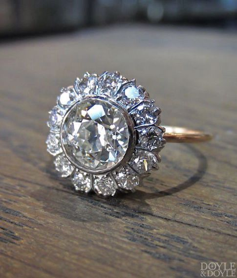Classic vintage diamond cluster engagement ring, from Doyle & Doyle. Click to see more diamond cluster rings!
