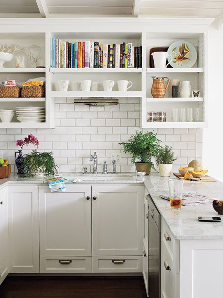 White subway tile and marble countertops- white kitchen. LOVE open cabinets.  Can't be cluttered.