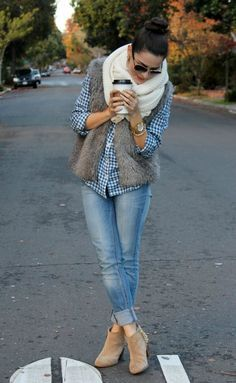 Blue and white button up shirt, skinny jeans, brown suede ankle boots, grey fur vest and white knit infinity scarf.