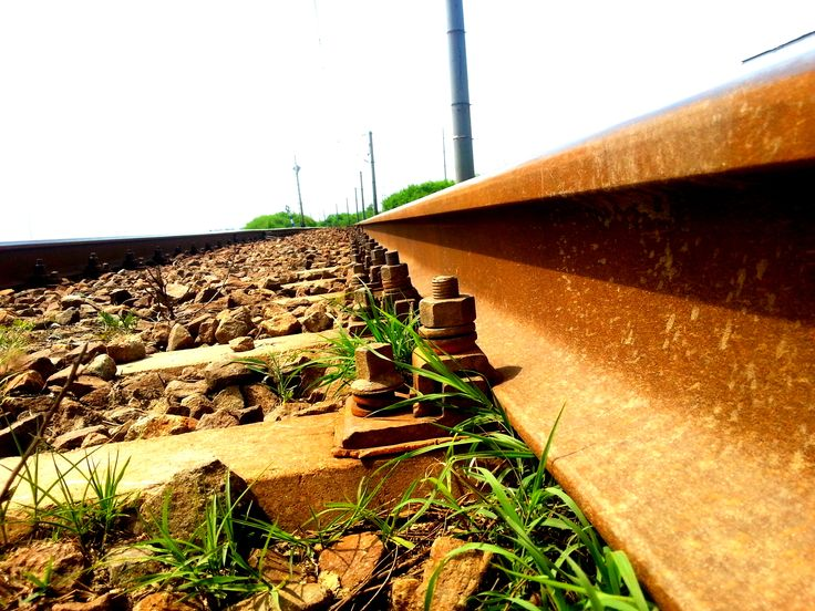 Rusty Iron Train Railway - Train Track;  (rail transport); detail over stones rail way