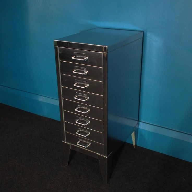 industrial polished steel filing cabinet with tapered legs by stor circa 1950s