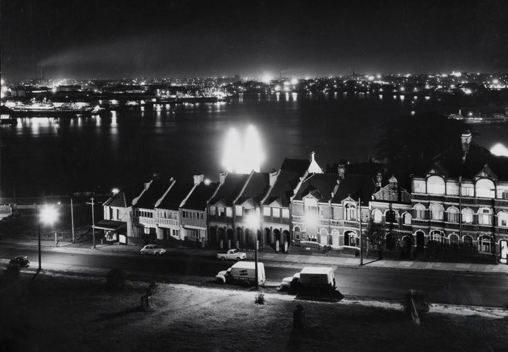 MAX DUPAIN (1911-1992) (Night Harbour View with Terrace Houses) - Price Estimate: $1500 - $2500