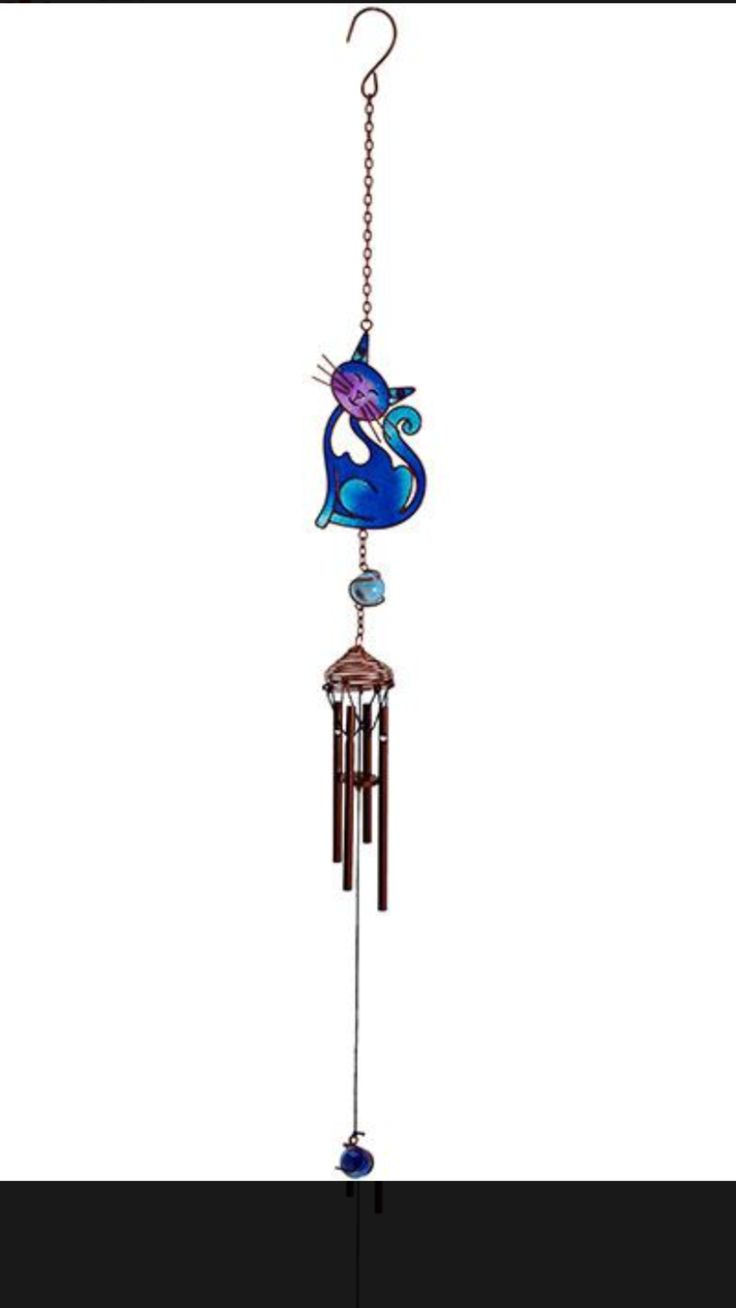 Purple Smiling Cat Windchime 💜 A beautiful purple hand crafted metal, glass & resin windchime in a smiling cat design. Ethically sourced.It is also suitable for indoor and outdoor display. Dimensions H:45.00cm x W:6.00cm x D:4.00cm £9