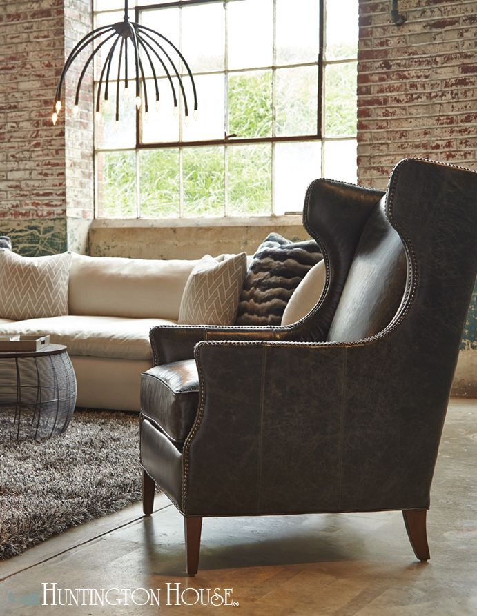 Beautiful modern wingback chair shown in a distressed black leather