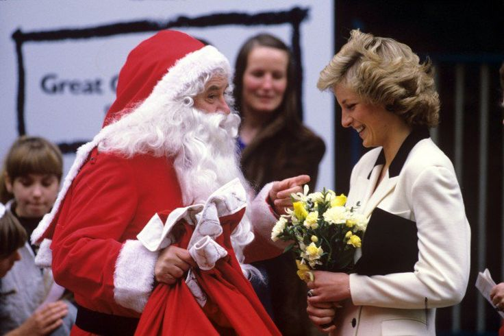 Princess Diana with comedian Jimmy Tarbuck dressed as Santa Claus at Great Ormond Street Hospital in 1987.