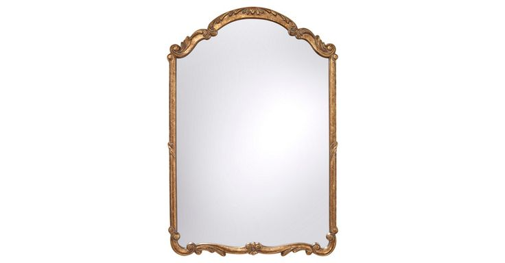 Featuring an antiqued-gold finish and ornate detailing on the frame, this mirror is elegant and timeless.