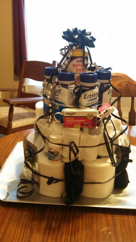 "Funny 60th Birthday Gift Idea for Dad. Collect together items that just say ""old"" like adult diapers and stomach pills. Then make into a cake design. This will go down well when presented at a birthday party."