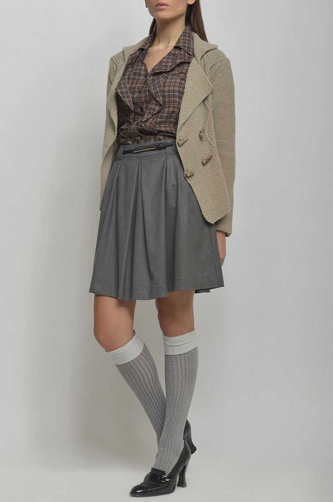 Double breasted cardigan/ Ruffled front checked shirt/ Pleated skirt/ Leather belt.