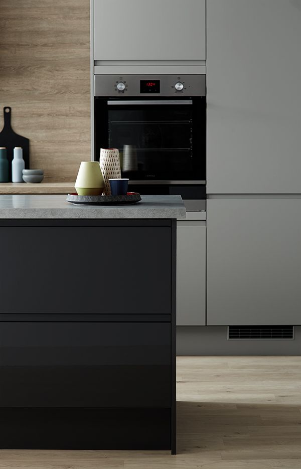 Mix matt kitchen cabinet doors with high gloss in a contrasting shade to get a modern and individual look to your kitchen. Be inspired by Howdens. Shown here is our Clerkenwell Matt Slate Grey and Graphite Gloss ranges.