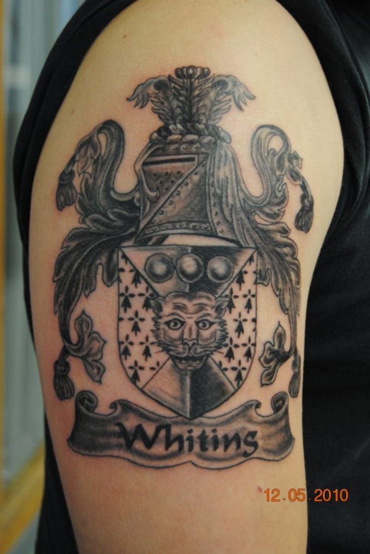 Beautiful grey ink family crest tattoo on half sleeve