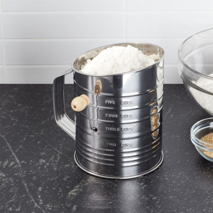 Shop Hand Crank 5-Cup Flour Sifter. Some things never go out of style, including this classic hand-crank sifter that aerates and mixes dry ingredients. Double wire agitators break up clumps as they pass through the stainless steel mesh screen.