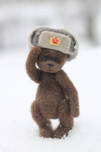 "Handmade felted toy ""Teddy bear and ushanka"" Size: 13 cm. Materials: 100% wool, glass beads, mineral granulate."