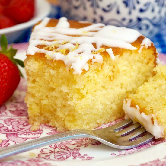 Lemon Drizzle Cake is a classic British treat. Buttermilk lemon cake soaked with a lemon sugar syrup and drizzled with tangy lemon icing.
