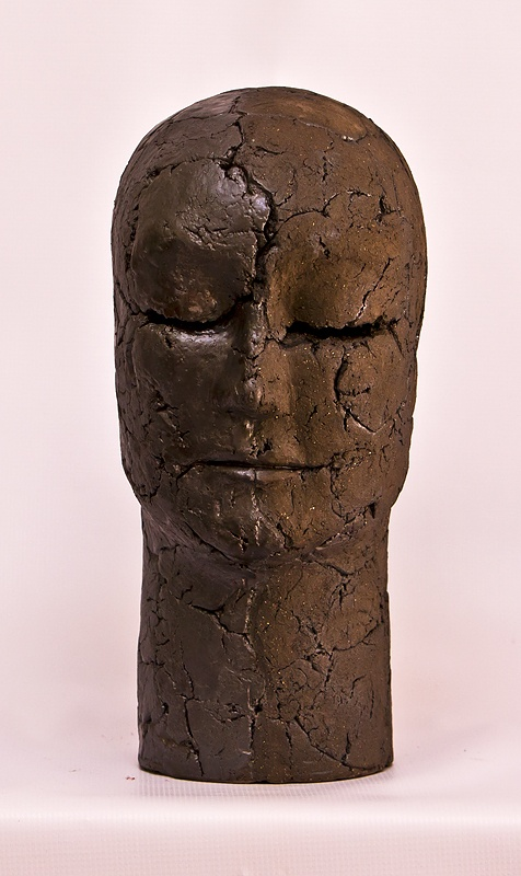 Head sculpture in basalt clay fired to earthenware