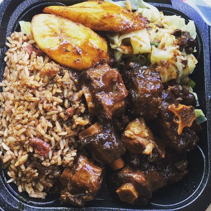this curry oxtail rice and peas plantains and veggies with