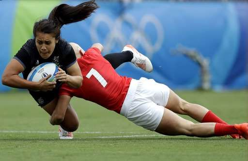 Australian women win 1st gold medal for Olympic rugby sevens - August 8, 2016 - New Zealand's Shakira Baker, left, is tackled by Great Britain's Heather Fisher, during the women's rugby sevens semi final match at the Summer Olympics in Rio de Janeiro, Brazil, Monday, Aug. 8, 2016. (AP Photo/Themba Hadebe) - August 8, 2016
