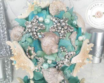 Boeket bruiloft bruids boeket met schelpen en zeesterren