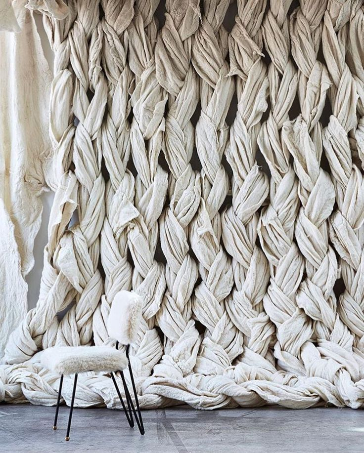 Could do this with vintage sheets. Braid together for a backdrop.