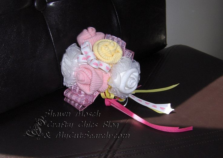 baby shower corsage made with baby items | ... Chics: Baby Shower . . . Diaper Cake, Party Favors, Corsage and Layout