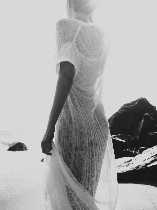luce del sole. sheer white dress. dreamy. ocean. beautiful black & white photography. woman.