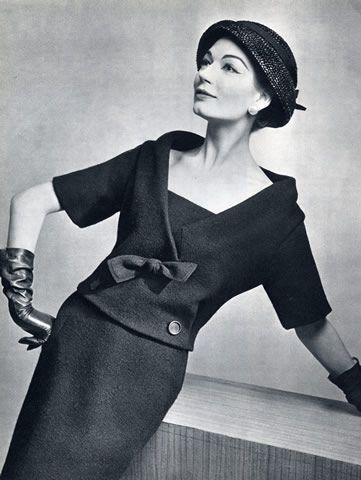 Christian Dior 1957. Simone is wearing a blue Shetland wool two-piece dress by Christian Dior, L'Officiel.
