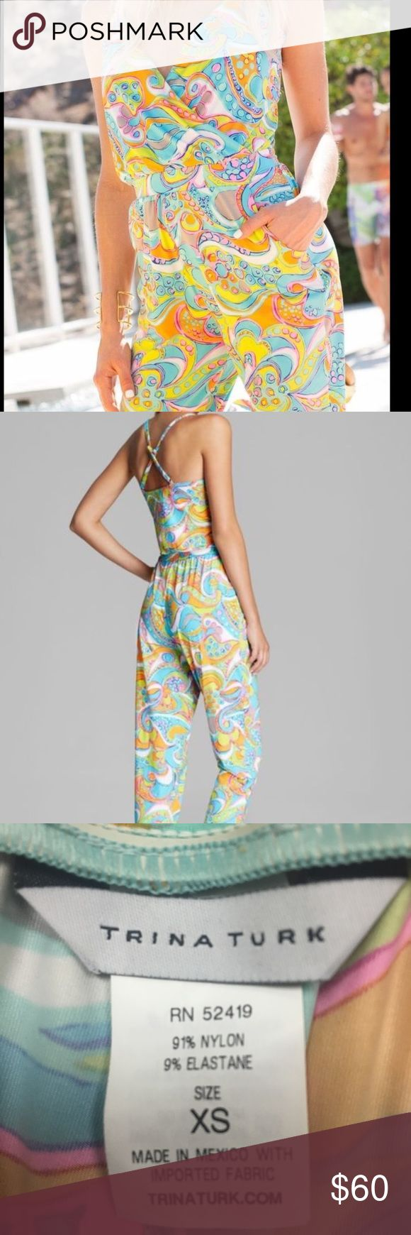 Trina Turk Jumpsuit Adjustable should straps that crisscross in the back.  Elastic high waist and elastic around ankle.  Never worn, purchased for vacation and never used. 91% nylon, 9% elastane. Trina Turk Pants Jumpsuits & Rompers