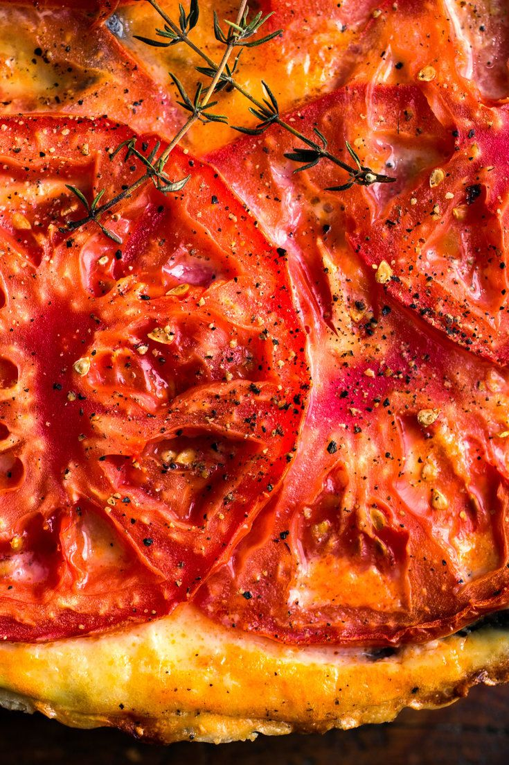 NYT Cooking: Tomatoes have another week or so to go in most farmers' markets. This robust summer pie, topped with a layer of tomato slices flecked with thyme, is a nice party piece. It also packs well once cooled, so take leftovers to work for lunch.