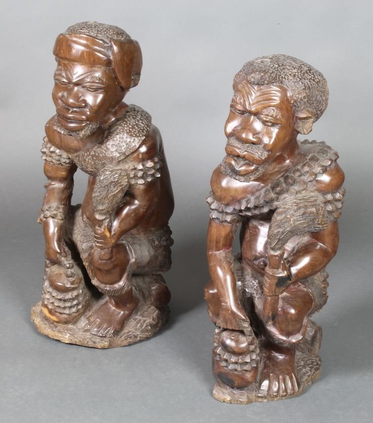 "Lot 182, A large and impressive pair of African carved wooden figures of seated gentleman 25""h, est £75-125"