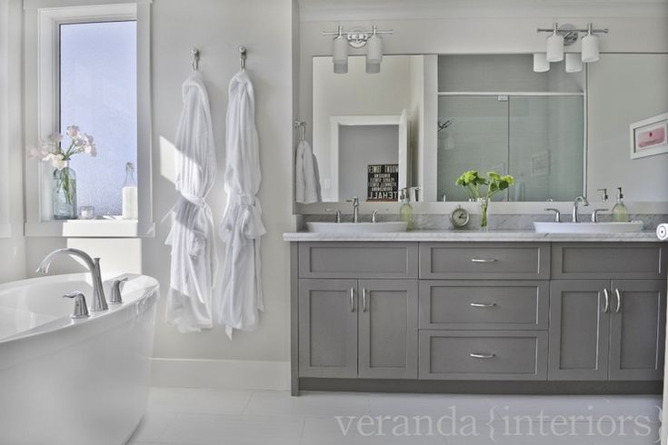 Grey vanity with Daltile Fabrique on the floor. Love these tiles, great, GREAT alternative for those who want light but not marble.