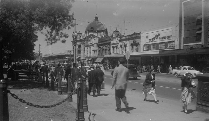 the Downyflake Restaurant Swanston Str. is seen second from the right. Loved watching the donuts being produced in the window as a child