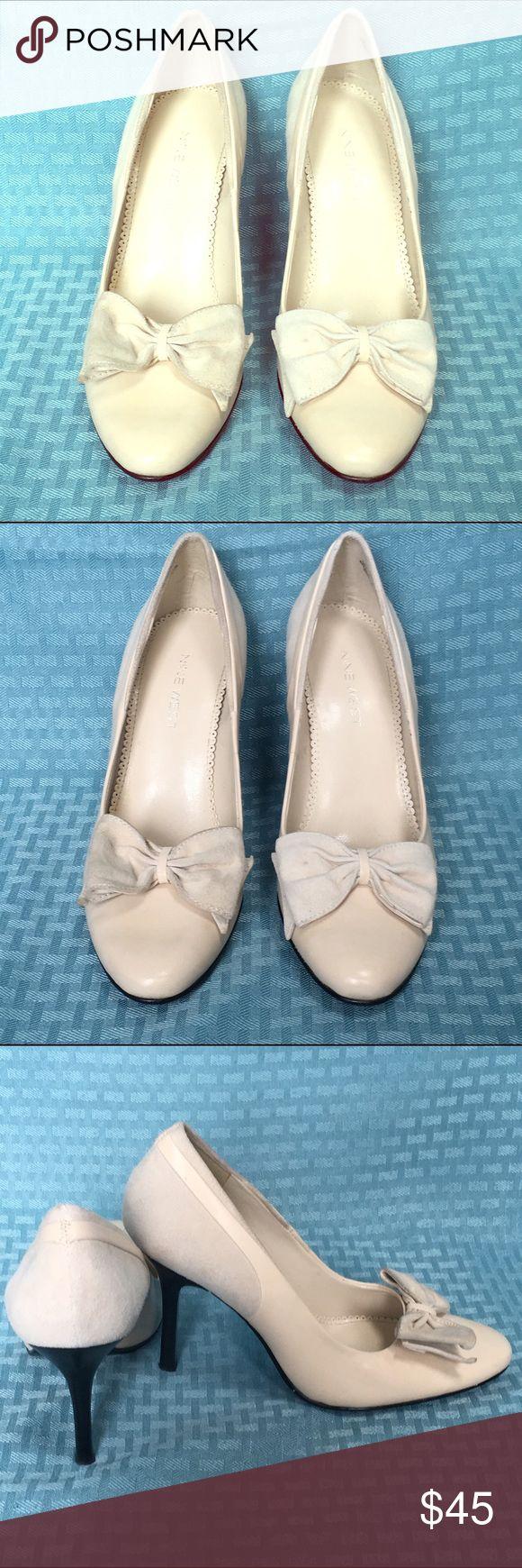 Nine West cream pumps with bow- size 6 Nine West cream pumps- suede and leather with suede bow. Barely worn. Size 6 Nine West Shoes Heels