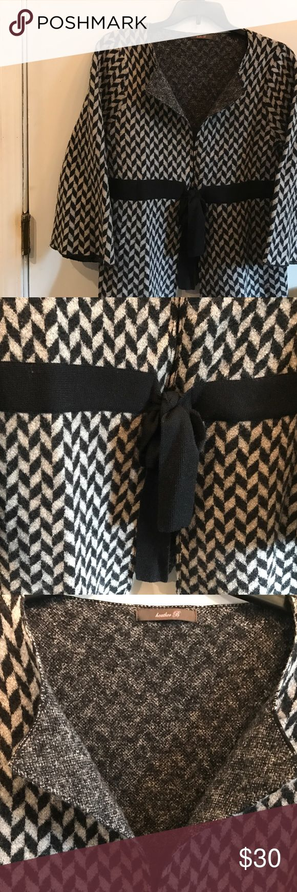 """Heather B wrap cardigan sweater Grey & black Sz XL Heather B wrap cardigan sweater! Grey & black chevron stripe. Sz XL bust 40"""". A simple way to look pulled together at work or luncheon! It could be a favorite addition to your wardrobe. Excellent Condition worn once. You will find this beautiful sweater to have no holes, stains, odors or pilling. Wool blend material. Check my closet for other similar items. No trades. heather b Sweaters Cardigans"""