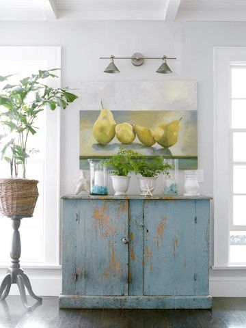 That distressed cupboard is great against the gray walls. The pear painting