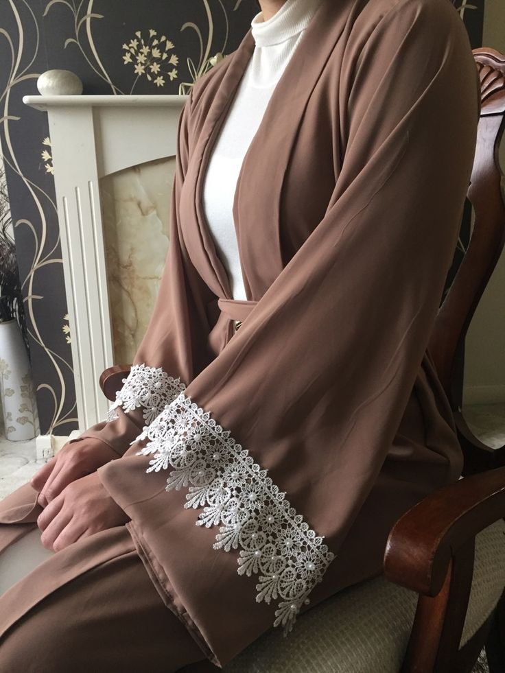 The reason we love this abaya is because of how elegant it is! The open abaya features a thick crochet trim with hand glued pearls, and comes with...