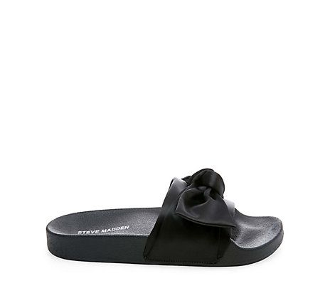 Slide into the most current, laidback trend in footwear. Shop Steve Madden  slides for a funky or fashionable approach to the convenient, casual sandal.